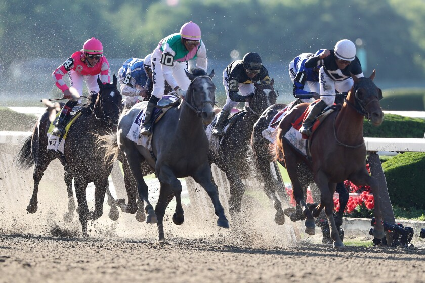 Jockey Joel Rosario rides Sir Winston, right, to victory during the 2019 Belmont Stakes.