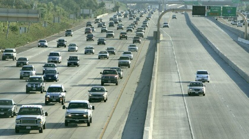 Smooth sailing in the evening rush hour on the high-occupancy-vehicle lanes on Interstate 15 near Carmel Valley Road.