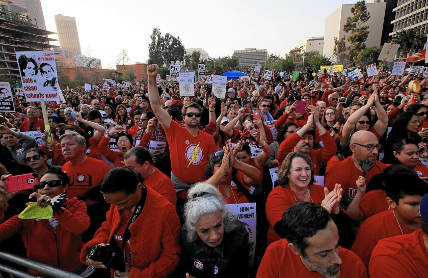 Members of United Teachers Los Angeles press their contract demands at a recent rally in downtown's Grand Park.