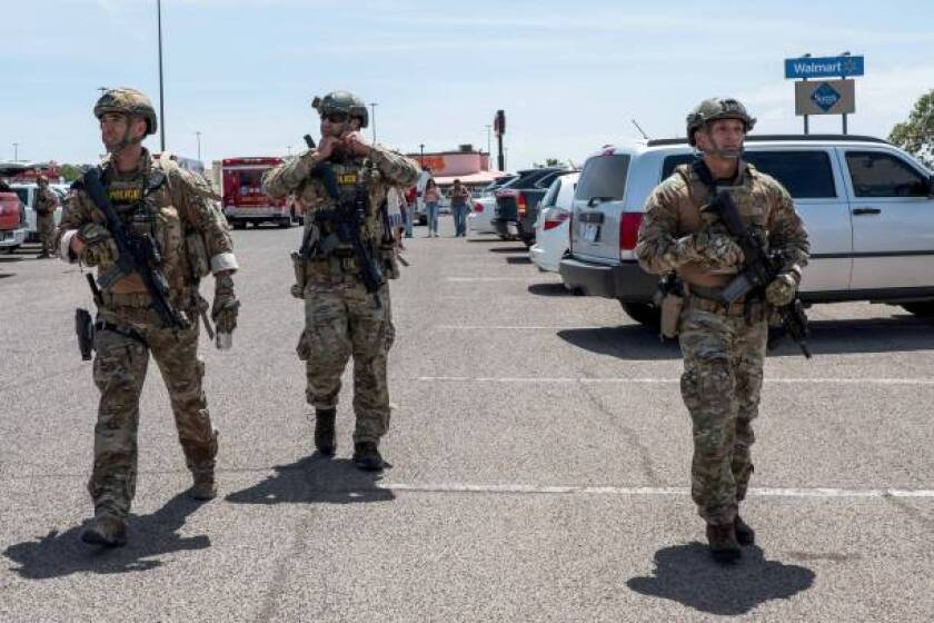 Law enforcement officials respond to a deadly shooting in El Paso.
