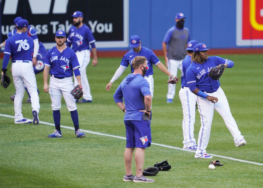 Toronto Blue Jays players warm up before an intrasquad scrimmage.