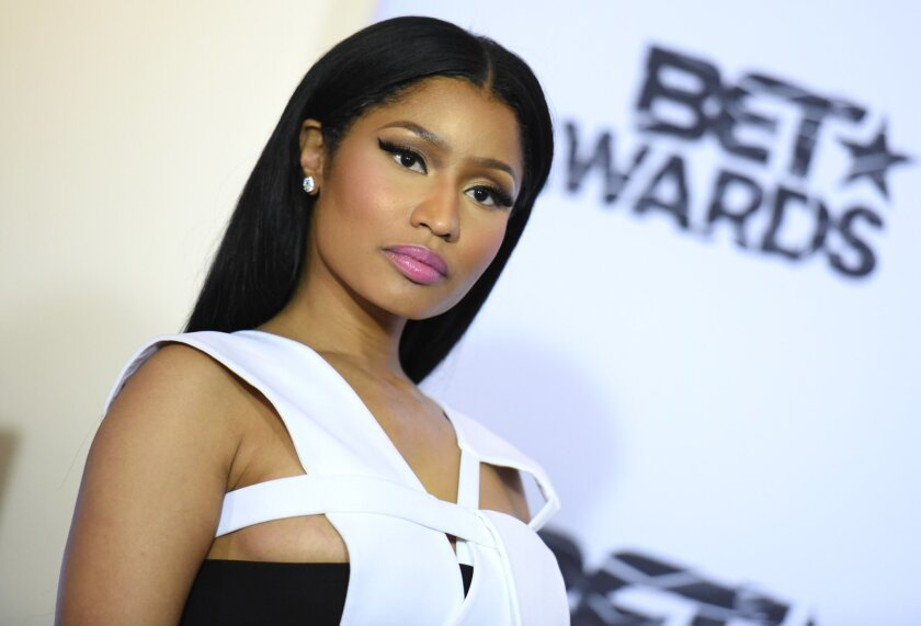 FILE - In this June 28, 2015 file photo, Nicki Minaj, winner of viewers choice and best female hip hop artist awards, poses in the press room at the BET Awards at the Microsoft Theater in Los Angeles. Madame Tussauds says employees at the Las Vegas museum will be closely monitoring a wax figure of Minaj after an image of a visitor posing suggestively with the statue appeared on social media.(Photo by Richard Shotwell/Invision/AP)
