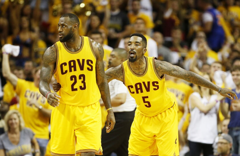 LeBron James and J.R. Smith react during the fourth quarter of an Eastern Conference finals game vs. Atlanta Hawks.