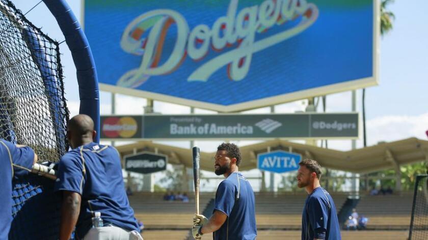 Padres Matt Kemp takes batting practice at Dodger Stadium before opening day. (K.C. Alfred)