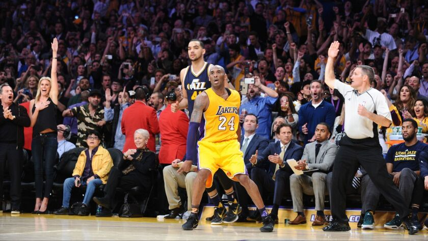 LOS ANGELES, CALIFORNIA APRIL 13, 2016-Lakers Kobe Bryant hits a three-pointer late in the 4th quart