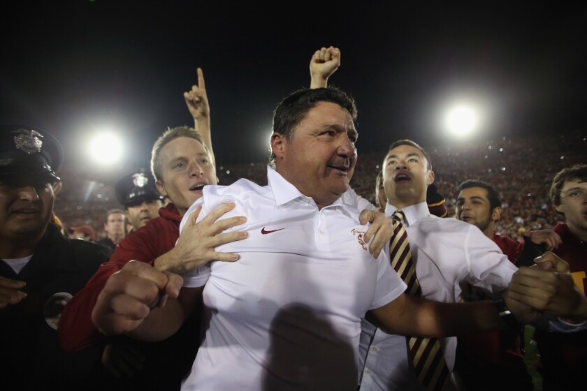 Ed Orgeron led USC to a 6-2 record during his time as interim coach with his loses only to Notre Dame and UCLA in 2013.