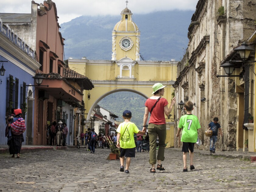 Katie Quirk and her sons, Liam and Reid, walk through the famous Santa Catalina Arch in the colonial city of Antigua.