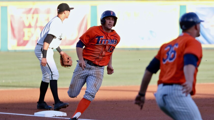 Cal State Fullerton shortstop Timmy Richards rounds third and scores a run against Long Beach S