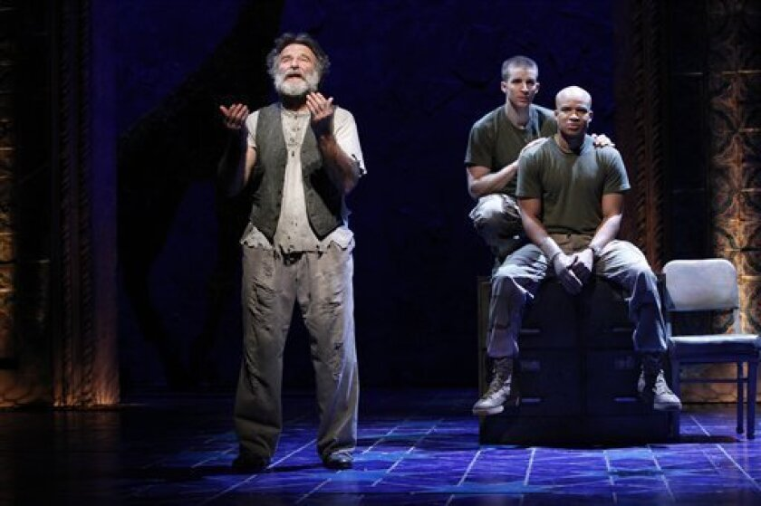 "In this undated theater publicity image released by Sam Rudy Media Relations, from left, Robin Williams,  Brad Fleischer and Glenn Davis are shown in a scene from ""Bengal Tiger at the Baghdad Zoo,"" at the Richard Rodgers Theatre in New York. (AP Photo/Sam Rudy Media Relations, Carol Rosegg)"