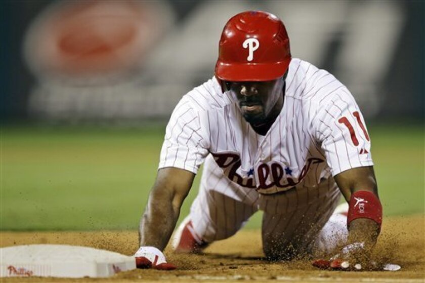 Philadelphia Phillies' Jimmy Rollins dives back to first base after a pick-off attempt by New York Mets relief pitcher Ramon Ramirez in the seventh inning of a baseball game, Tuesday, Aug. 28, 2012, in Philadelphia. New York won 9-5 in 10 innings. (AP Photo/Matt Slocum)