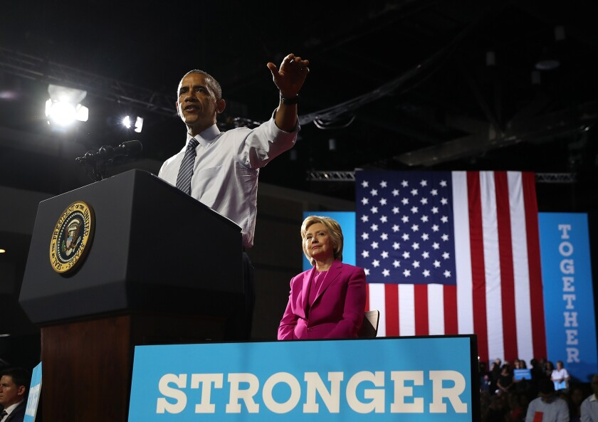 President Obama campaigns with Hillary Clinton on Tuesday in Charlotte, N.C.