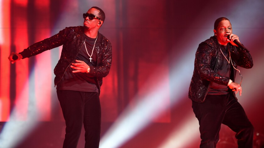 Mase, right, and Puff Daddy onstage for the Puff Daddy and Bad Boy Family Reunion Tour on Sunday at Madison Square Garden in New York.