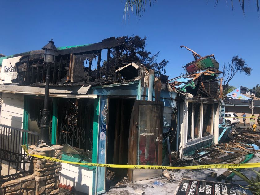 Firefighters worked for hours putting out a stubborn blaze that destroyed the iconic Mozy Cafe in Leucadia and three other businesses in the same building on Monday. A neighbor called 911 to report the fire shortly after midnight.