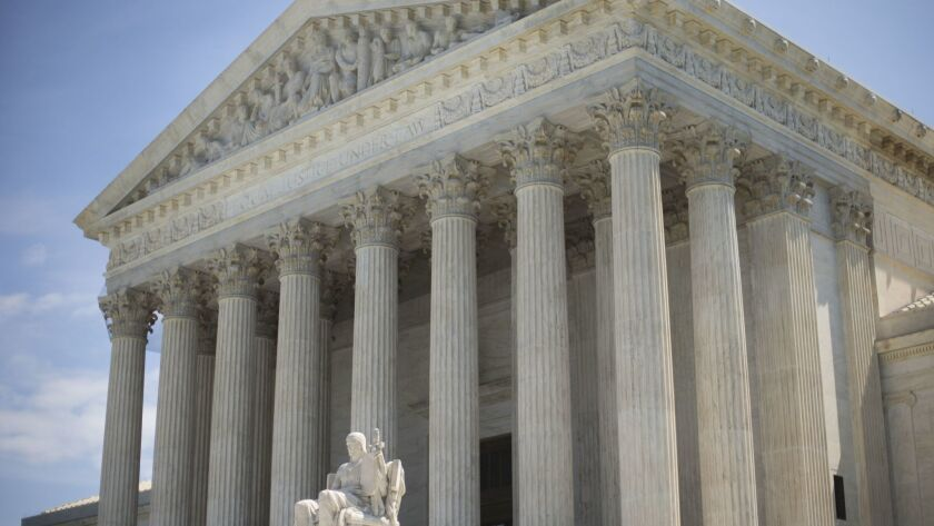FILE - This Monday, June 30, 2014, file photo shows the Supreme Court building in Washington. No one
