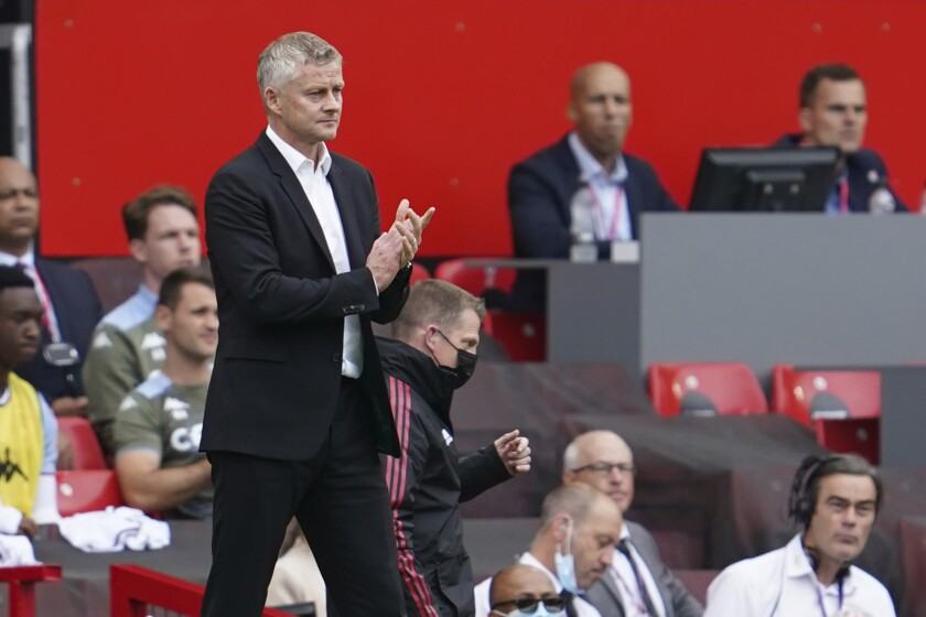 Manchester United's manager Ole Gunnar Solskjaer reacts during the English Premier League soccer match between Manchester United and Aston Villa at the Old Trafford stadium in Manchester, England, Saturday, Sept 25, 2021. (AP Photo/Jon Super)