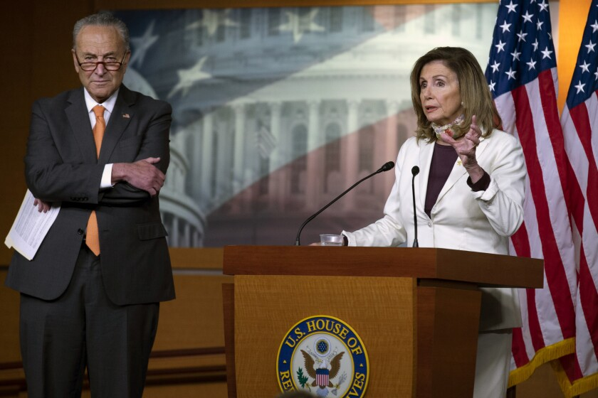 House Speaker Nancy Pelosi of Calif., joined by Senate Minority Leader Sen. Chuck Schumer of N.Y., speaks during a news conference on Capitol Hill in Washington, Thursday, Aug. 6, 2020. (AP Photo/Jose Luis Magana)