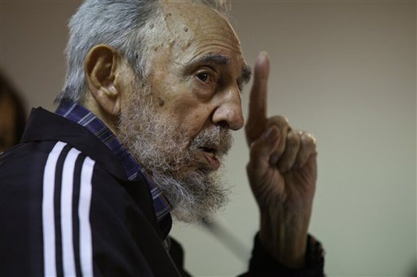 In this photo released on Feb. 4, 2012 by the state media website Cubadebate, Cuba's leader Fidel Castro speaks during the presentation of his book 'Guerrillero del Tiempo,' or 'Time Warrior' in Havana, Cuba, Friday, Feb. 3, 2012. (AP Photo/Cubadebate, Roberto Chile)