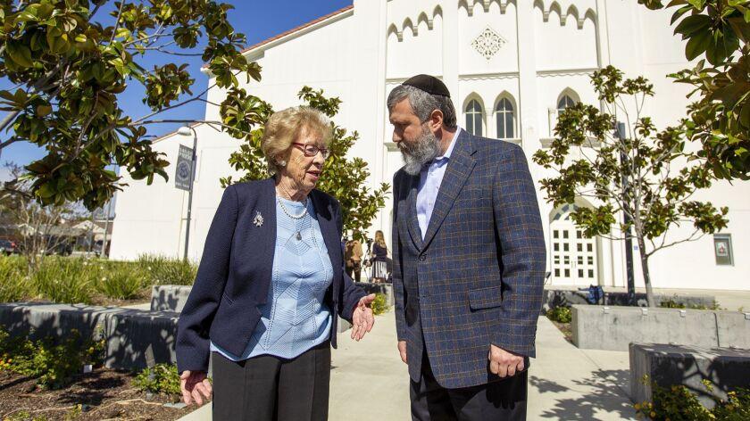 Eva Schloss, 89, a Holocaust survivor and Anne Frank's stepsister, speaks with Chabab Rabbi Reuven M