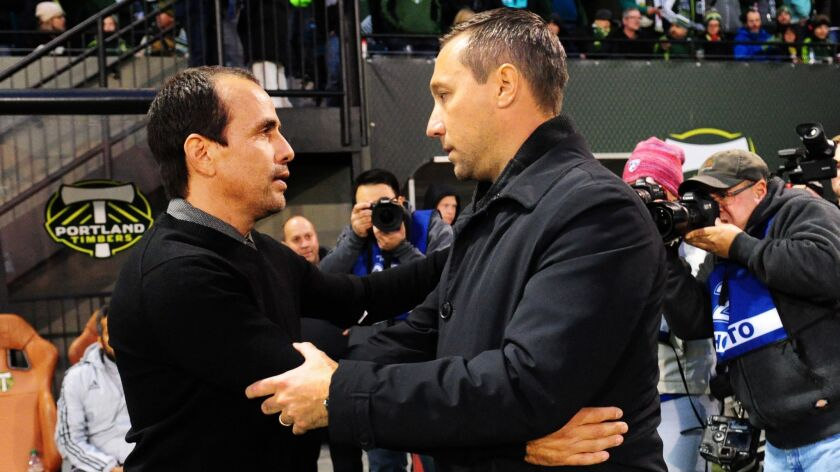 New Xolos coach Oscar Pareja (left), shown here while with FC Dallas, greeting Portland Timbers coach Caleb Porter before a 2015 MLS game.
