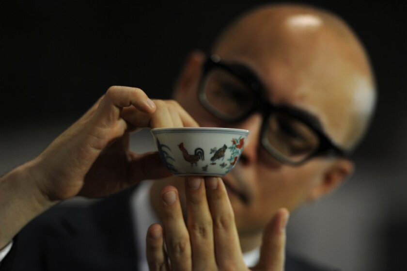 A rare, 15th century Chinese cup broke the world auction record for any Chinese porcelain, selling in Hong Kong for $36 million.