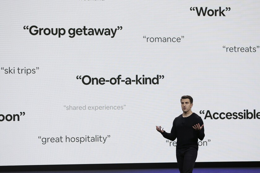 """FILE - In this Feb. 22, 2018, file photo, Airbnb co-founder and CEO Brian Chesky speaks during an event in San Francisco. Thirteen years after its founders first rented air mattresses in their San Francisco apartment, Airbnb is making its long-awaited stock market debut. The home sharing company priced its shares at $68 apiece late Wednesday, Dec. 9, 2020 giving it an overall value of $47 billion. Starting Thursday, it will trade on the Nasdaq Stock Market under the symbol """"ABNB."""" (AP Photo/Eric Risberg, File)"""