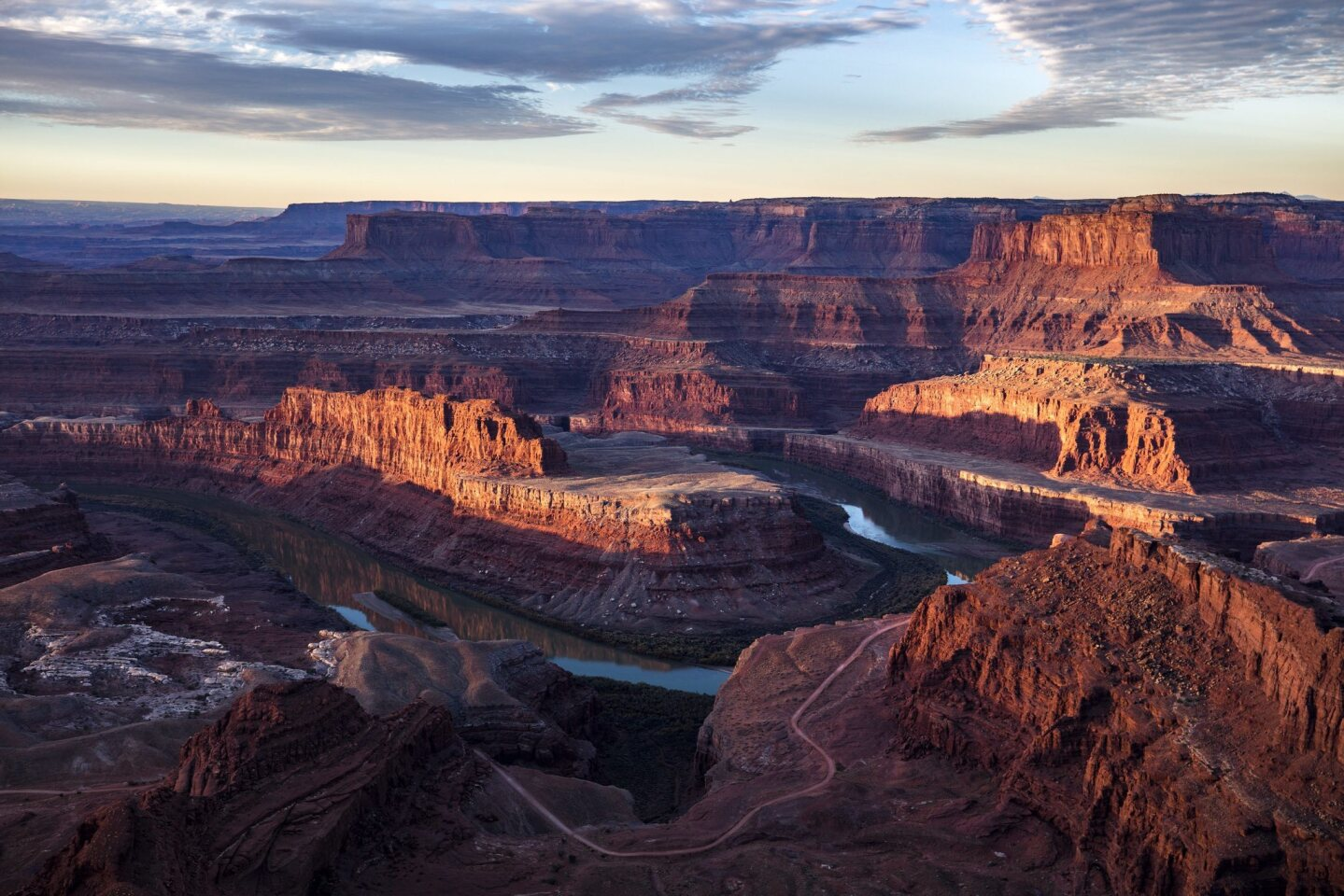 The Colorado River winds around the northern reaches of the Bear Ears National Monument, with Canyonlands National Park in the background, viewed from Dead Horse Point State Park near Moab, Utah.