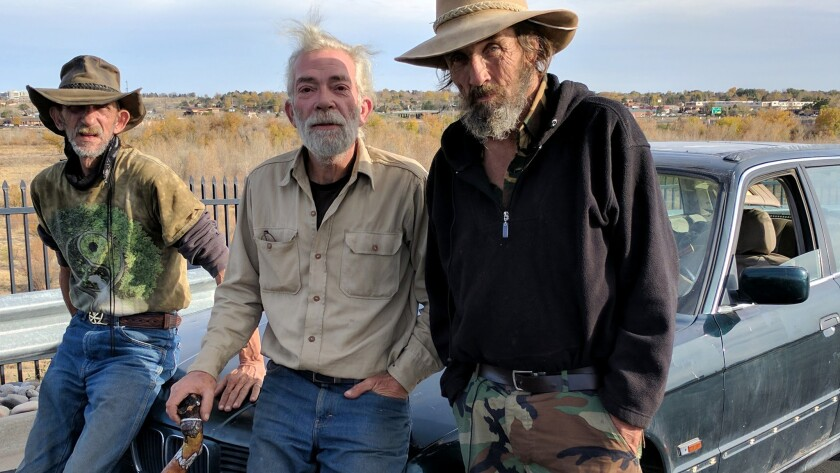 Larry Carlisle, center, set off from Oklahoma City for a new life in Pueblo, Colorado. The 58-year-old Carlisle camps out with friends who go by the names Cactus, left, and Cowboy.