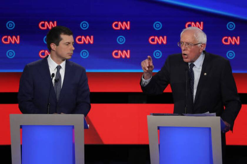 Bernie Sanders speaks while Pete Buttigieg listens during the July 30 Democratic presidential candidates debate in Detroit.