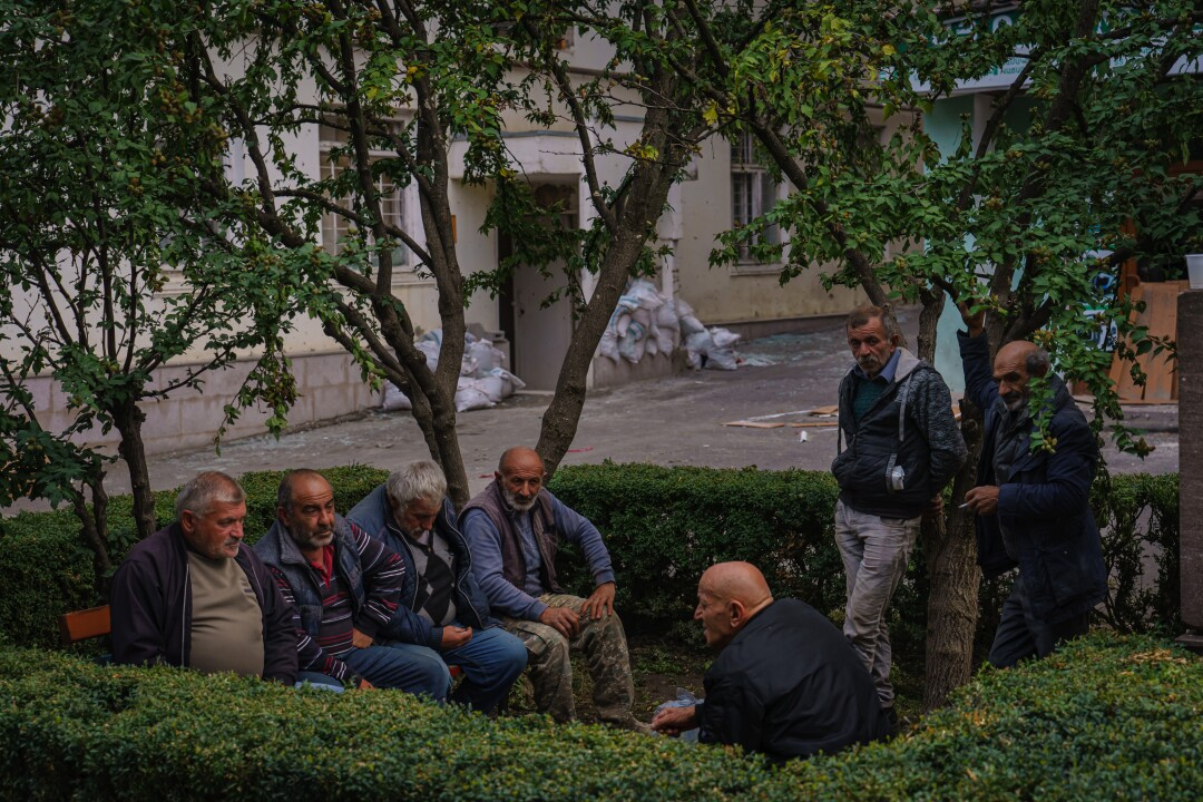 Men gather around to smoke and chat near a telecom company in Stepanakert.