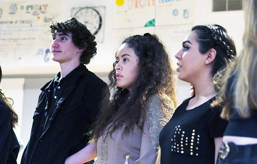 LACHSA students Drew Harris, left, Alondra Santos and Estefani Lopez in opera class.