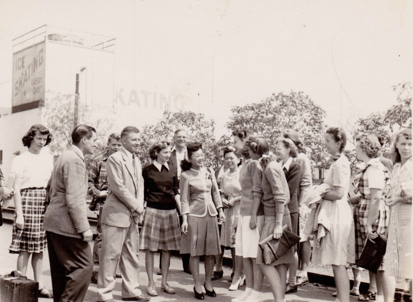 Esther is greeted by students at Pasadena Junior College