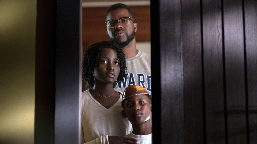 "(L-R) - Lupita Nyong'o, Winston Duke, and Evan Alex in a scene from ""Us."" Credit: Claudette Barius/U"