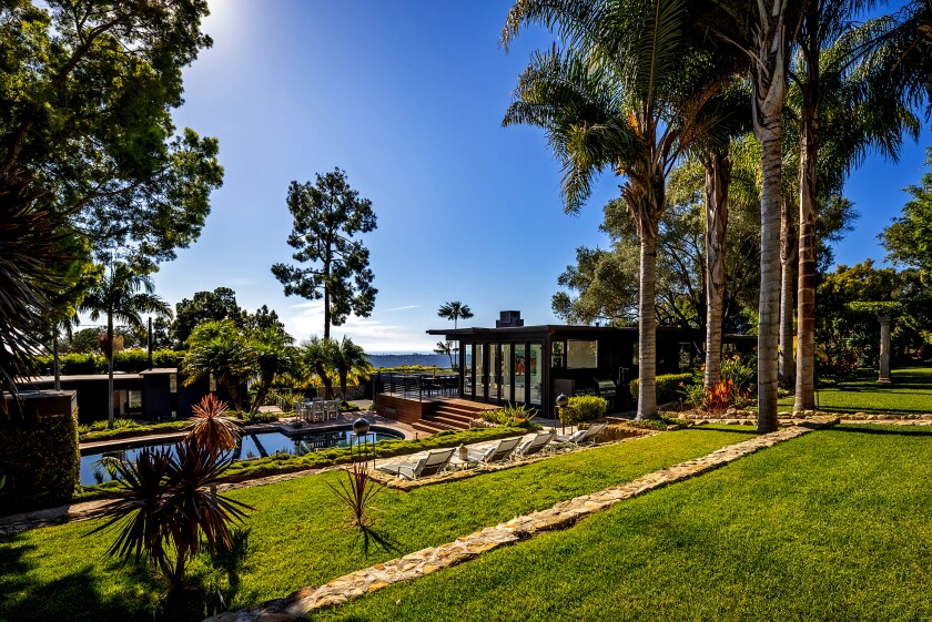 Sprawled across a scenic acre in the hills of the Riviera, the Midcentury compound includes a main house, guesthouse and a variety of leafy outdoor spaces.