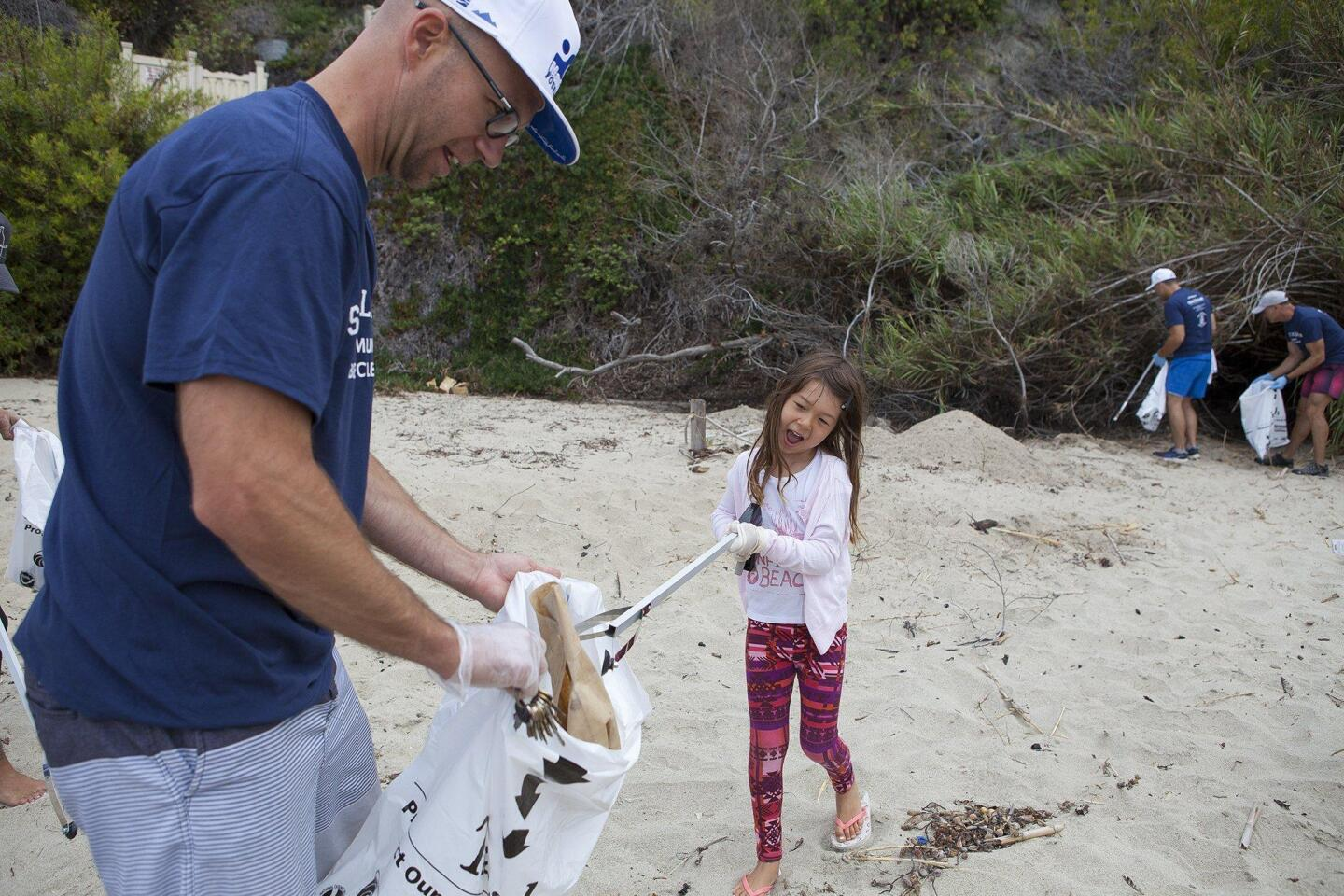 Photo Gallery: Volunteers help clean up Thousand Steps Beach