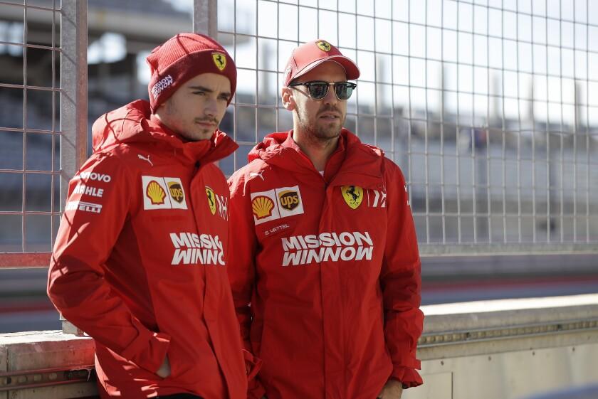 Ferrari driver Charles Leclerc, of Monaco, and Ferrari driver Sebastian Vettel, of Germany, pose for a photo during the Formula One U.S. Grand Prix auto race at the Circuit of the Americas, Thursday, Oct. 31, 2019, in Austin, Texas. (AP Photo/Darron Cummings)