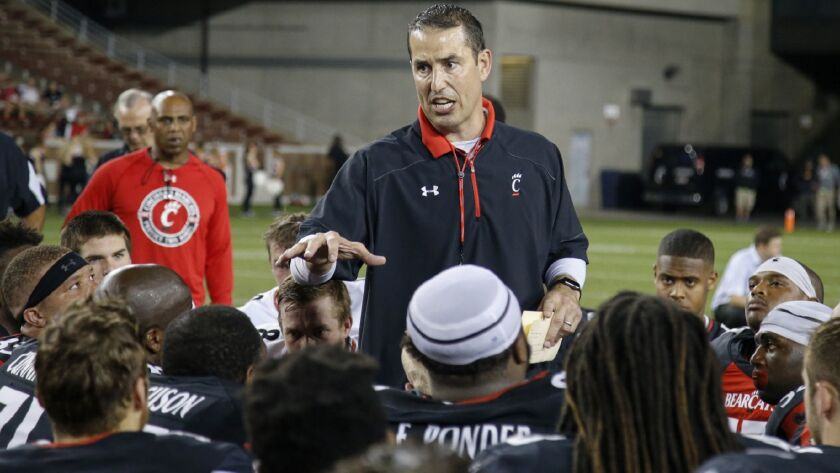 Cincinnati head football coach Luke Fickell, neter, talks to his team after an NCAA college spring f