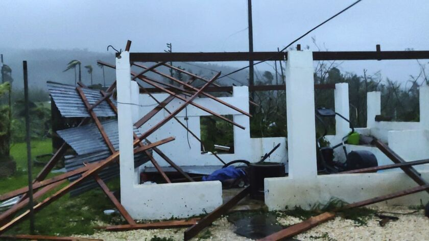 In this photo provided by Glen Hunter, damage from Super Typhoon Yutu is shown outside Hunter's home