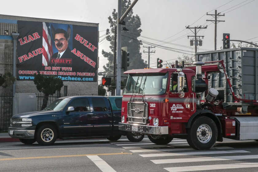 A banner calling Baldwin Park Councilman Ricardo Pacheco a liar and a bully hangs from Albert Ehlers' business on Ramona Boulevard.