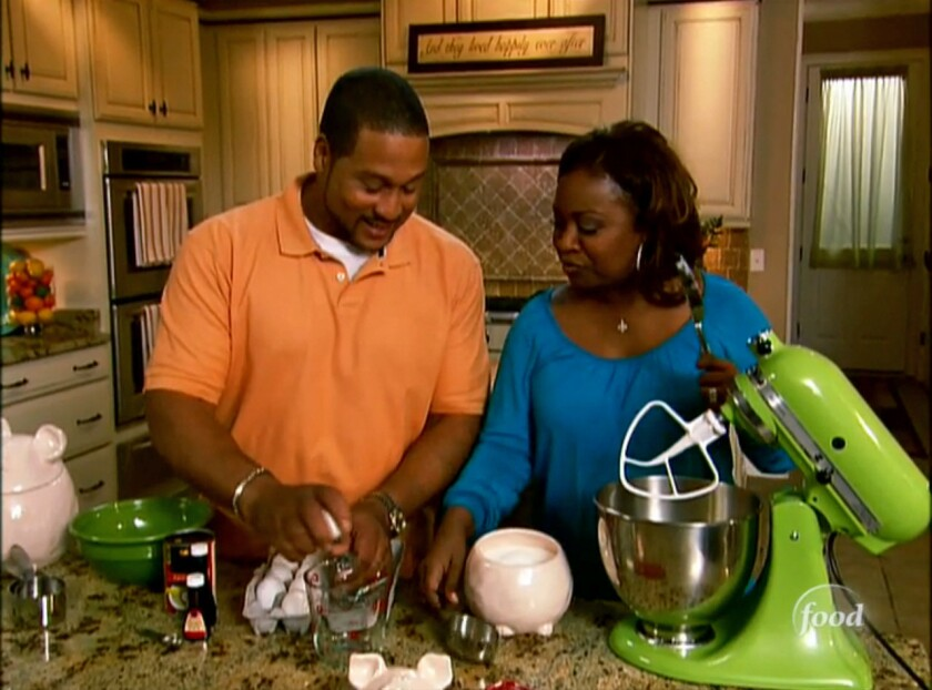 """Pat, left, and Gina Neely work together during an episode of their Food Network show """"Down Home With the Neelys."""" The two are getting a divorce."""