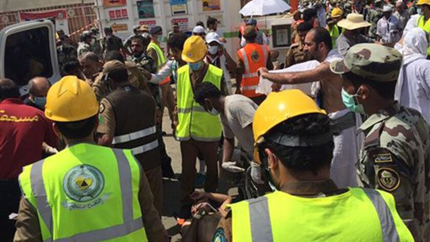 In an image from the Twitter feed of the Saudi civil defense, rescue crews respond to the stampede in Mina, Saudi Arabia.