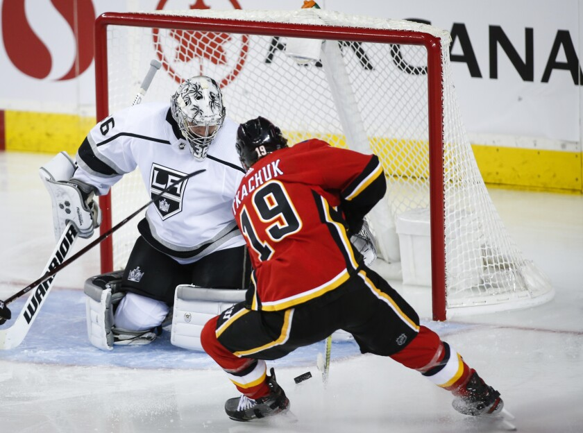 Kings goalie Jack Campbell, left, blocks Calgary's Matthew Tkachuk during the second period Tuesday night.