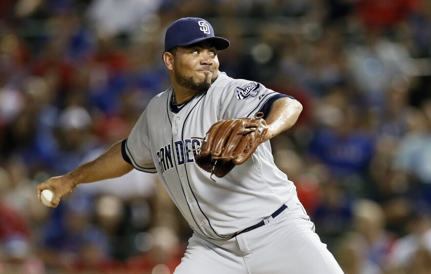 San Diego Padres relief pitcher Joaquin Benoit works against the Texas Rangers during the eighth inning of a baseball game Saturday, July 11, 2015, in Arlington, Texas. (AP Photo/Tony Gutierrez)