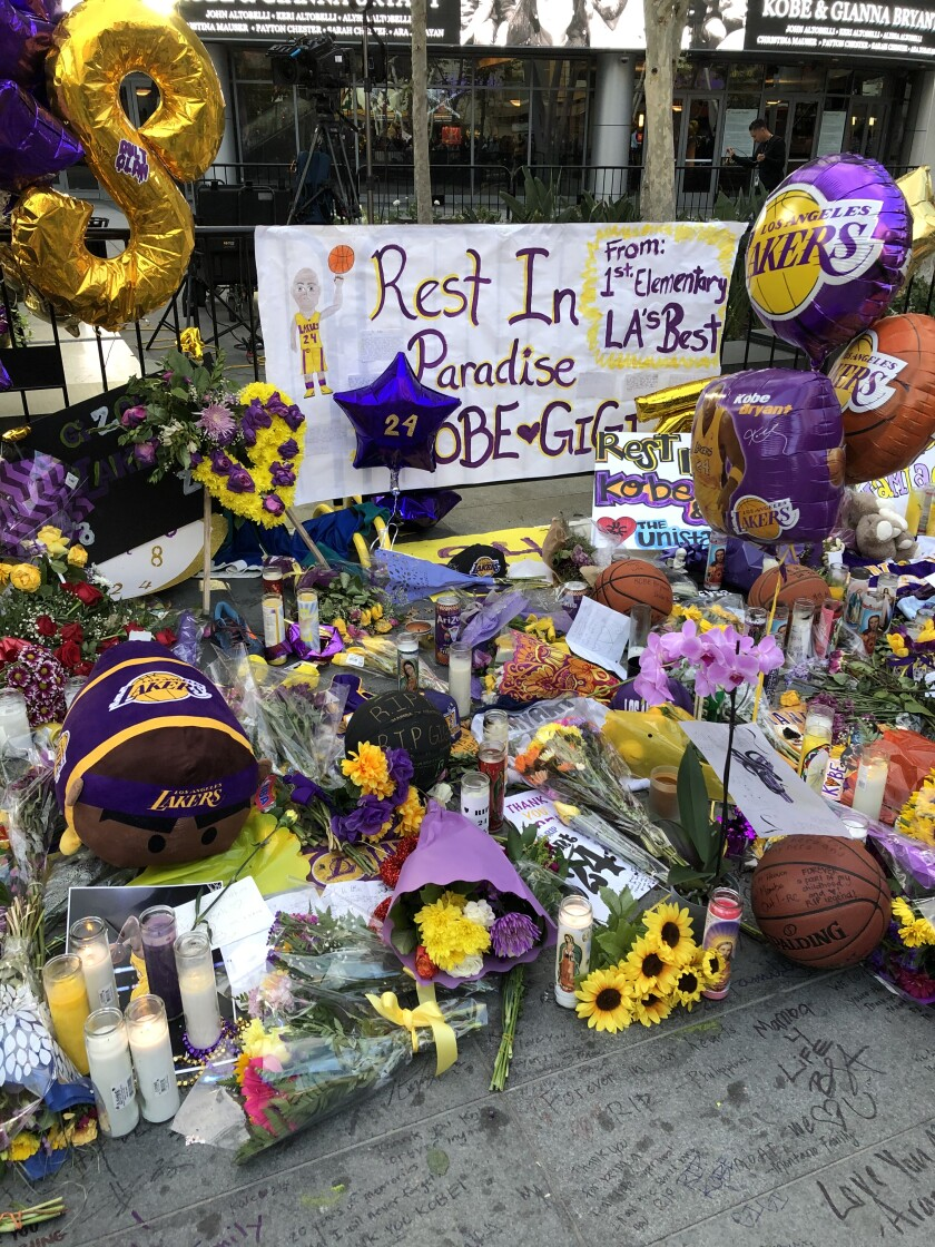 Flowers and tributes to former Lakers star Kobe Bryant, his daughter Gianna and the seven other victims of a helicopter crash are seen outside Staples Center and L.A. Live on Jan. 30.