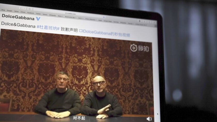 FILE - In this Nov. 23, 2018, file photo, founders of Dolce&Gabbana Domenico Dolce, left and Stefan