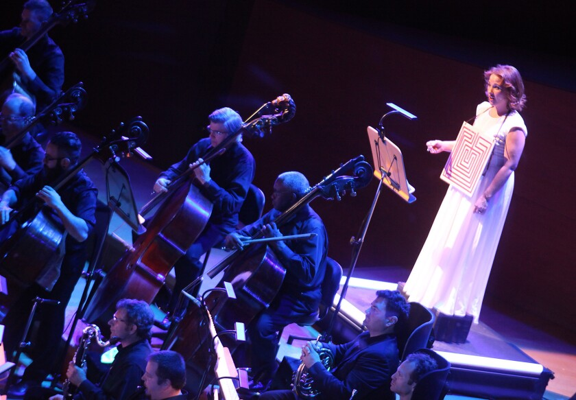 "Soloist Sasha Cooke, right, onstage with the L.A. Philharmonic in performance of Philip Glass' score to Rome section of Robert Wilson's ""The CIVIL warS."""