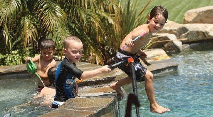 Kindergartners play at a Newcomers Pool Party. Photo: Jon Clark