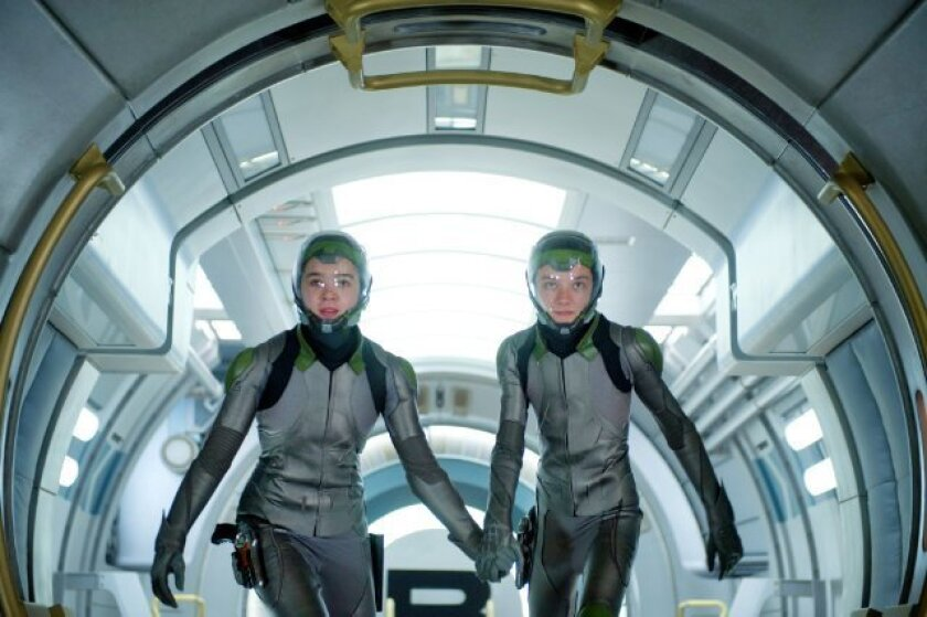 "Asa Butterfield, left, and Hailee Steinfeld star in ""Ender's Game."""