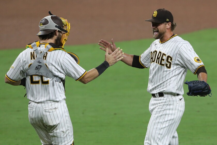 Trevor Rosenthal of the San Diego Padres celebrates a game and series win against the St. Louis Cardinals with Austin Nola