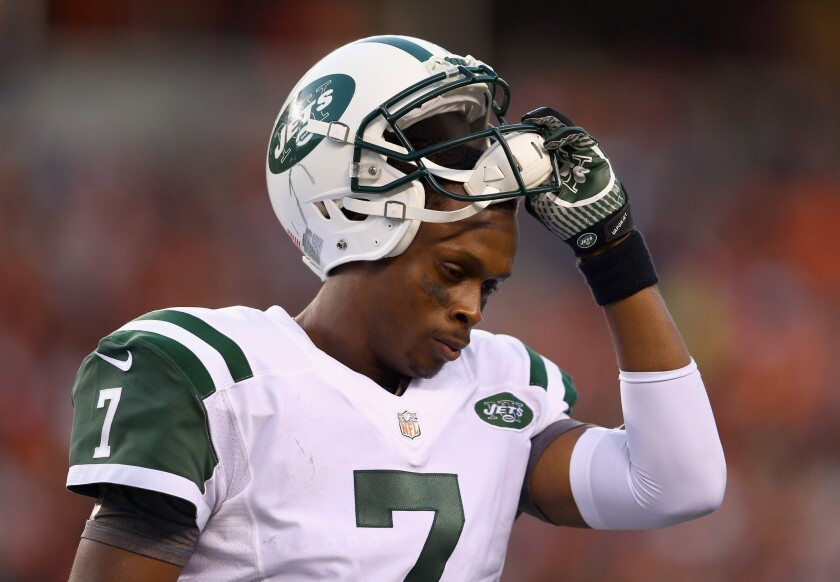 Jets quarterback Geno Smith leaves the field after having a pass intercepted and returned for a touchdown by the Bengals on Sunday.