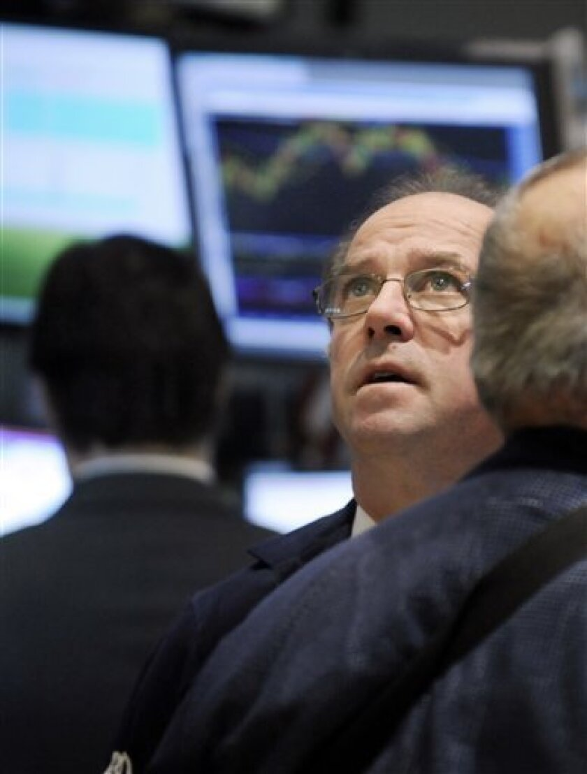 Traders work on the floor of the New York Stock Exchange Wednesday, Jan. 14, 2009. (AP Photo/Richard Drew)